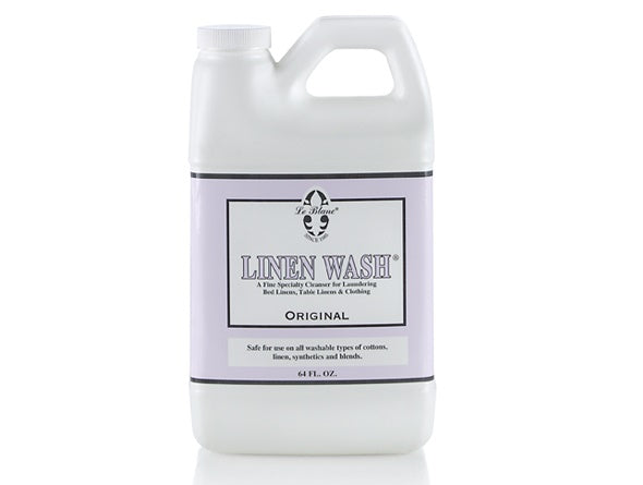 A bottle of Linen Wash to help you care for your fine linens properly