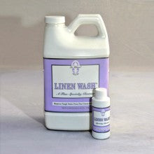 A bottle of linen wash, made for luxury linen care