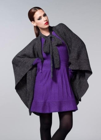 Charcoal knit shawl with a simple border worn over a bright purple knit dress
