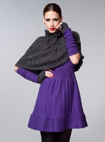 A short charcoal knit cape worn over a bright purple knit dress with matching purple sleeveless gloves
