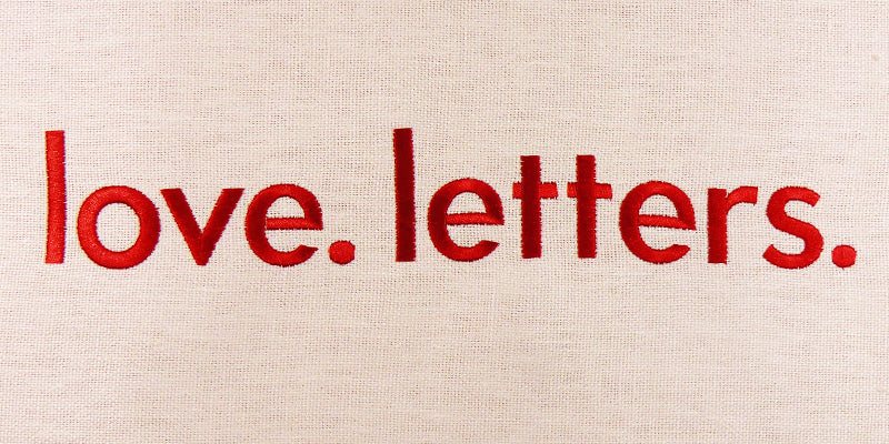 Red embroidery reading love. letters.