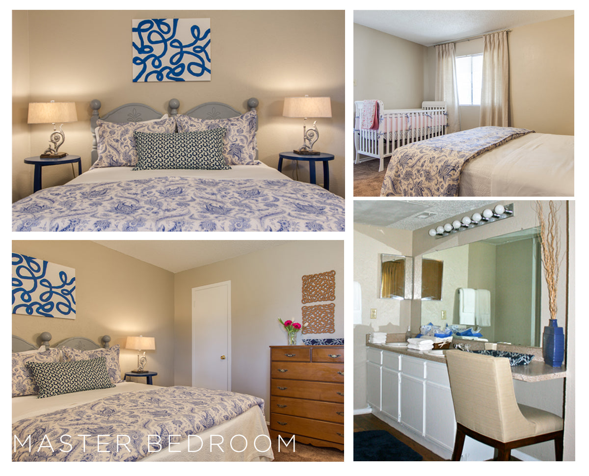 The master suite delights with crisp white and blue linens and abstract artwork