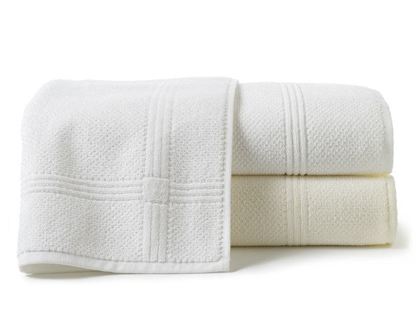 White textured bath towels with cross hatched detailing