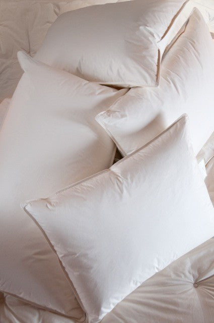 A pile of white bed pillows