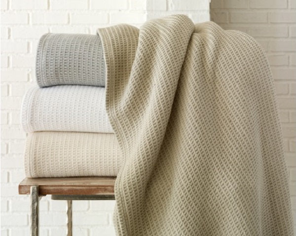 Waffle weave blankets in various neutral colors