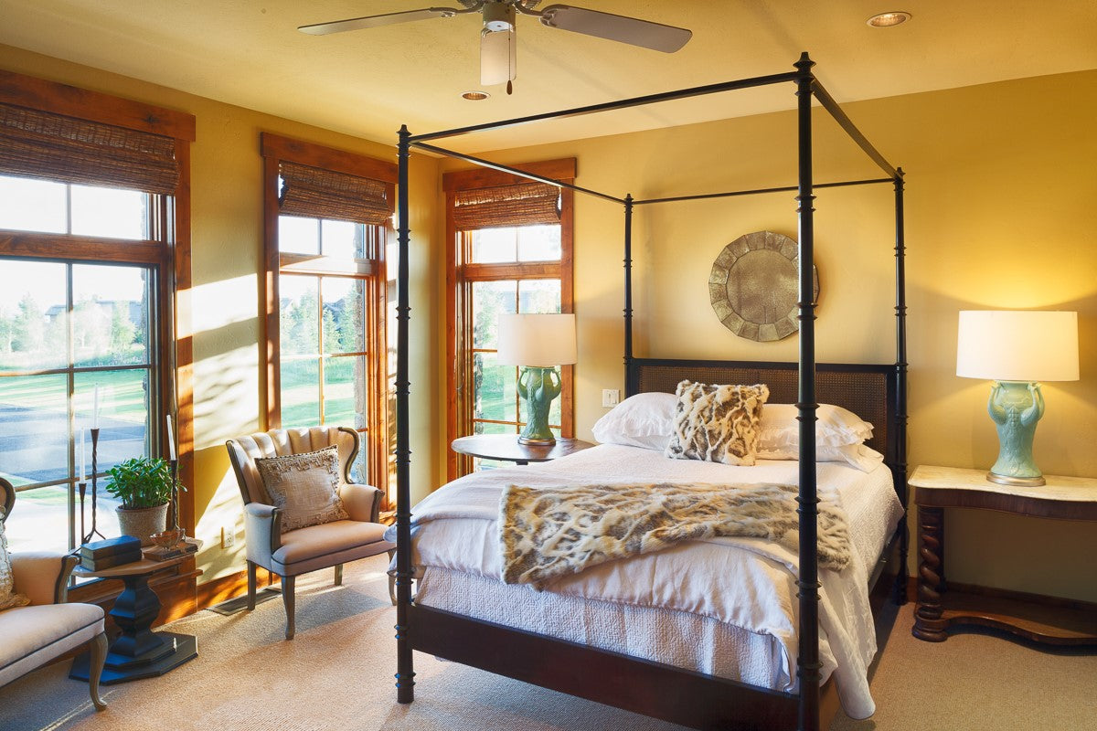 Master Bedroom featuring warm wood tones and crisp white bedding