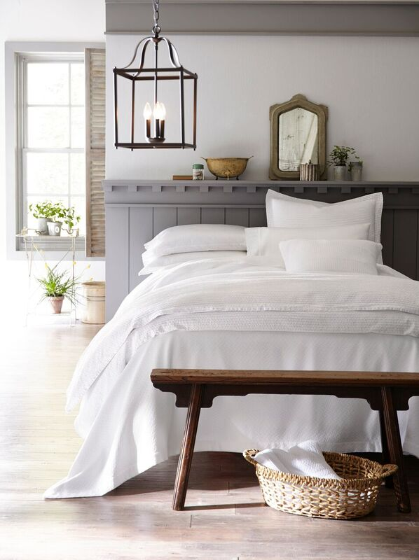 All white bed in a country-chic home