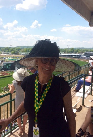 Mary Ella Gabler poses in her black and leopard hat at the Kentucky Derby