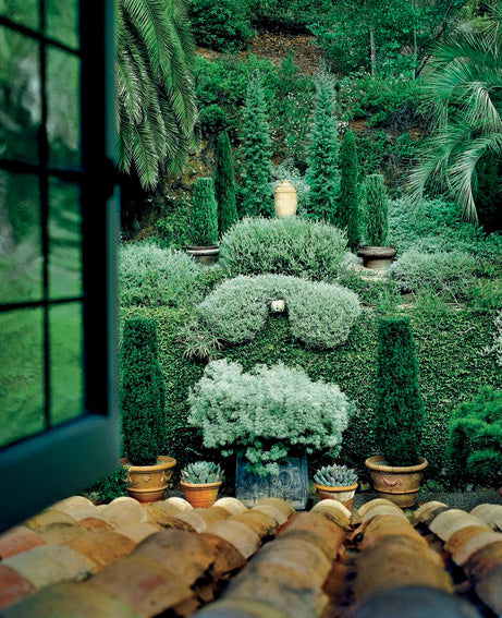 View into a terraced garden from a second floor window