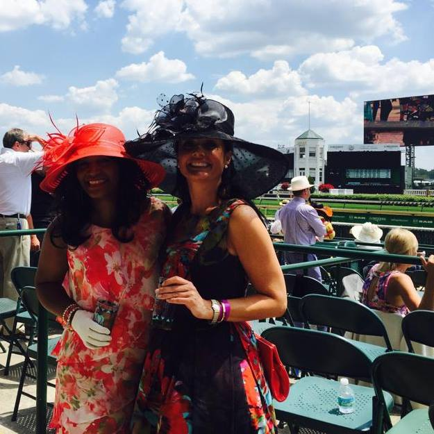 Two lovely ladies all dolled up for the Kentucky Derby in red and black florals