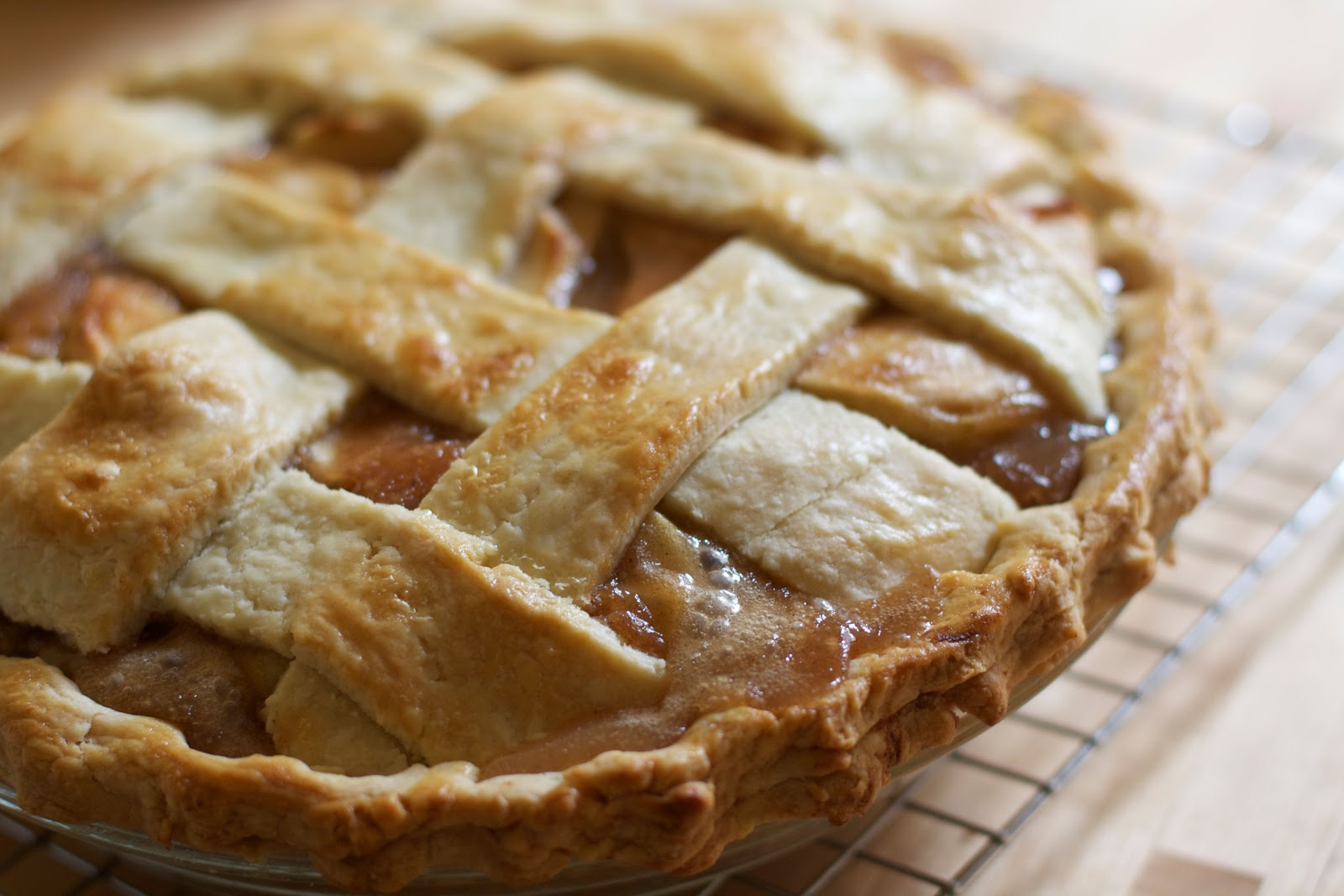 Close up shot of an apple pie with lattice crust