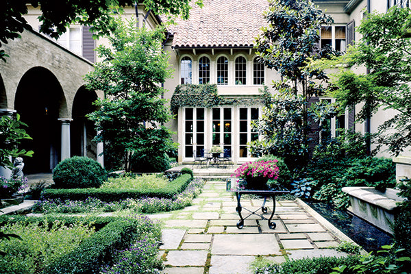 McAlpine Tankersley Architecture courtyard with sculpted gardens and potted flowers