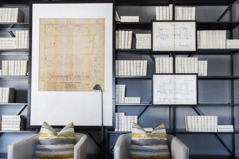 Single color bookshelves with maps and blueprints