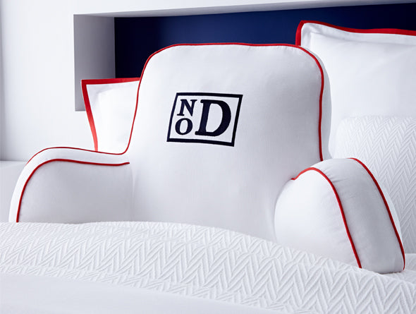 White bed rest with red accents and black modern monogram