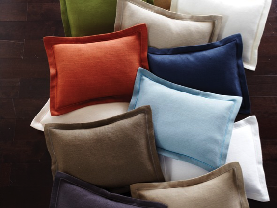 A dozen pillows in various colors