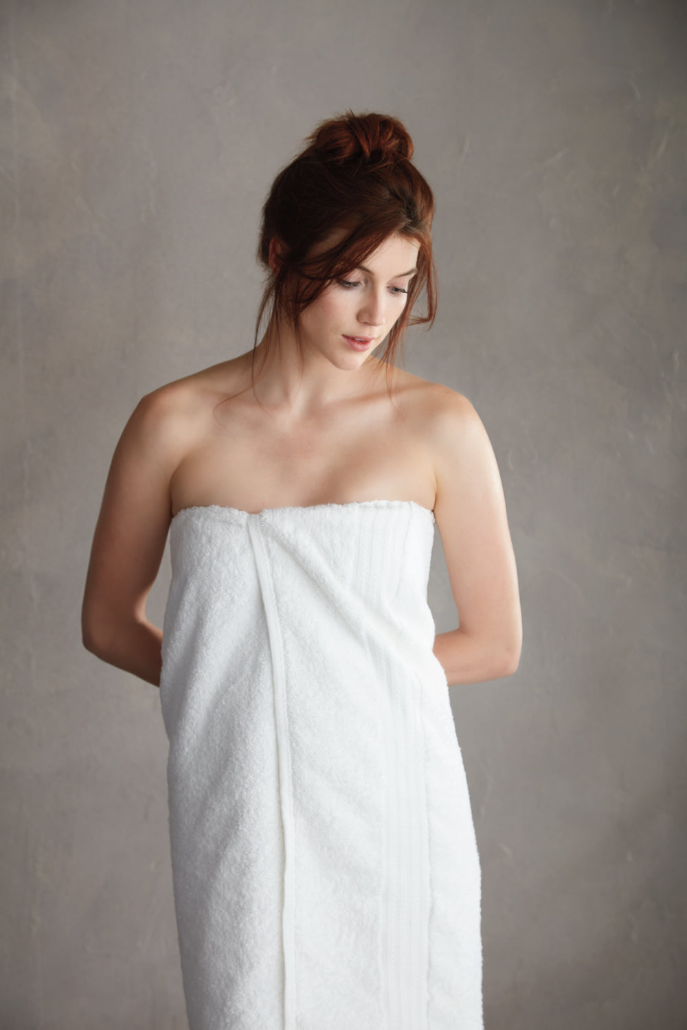 Woman wrapped in long white towel