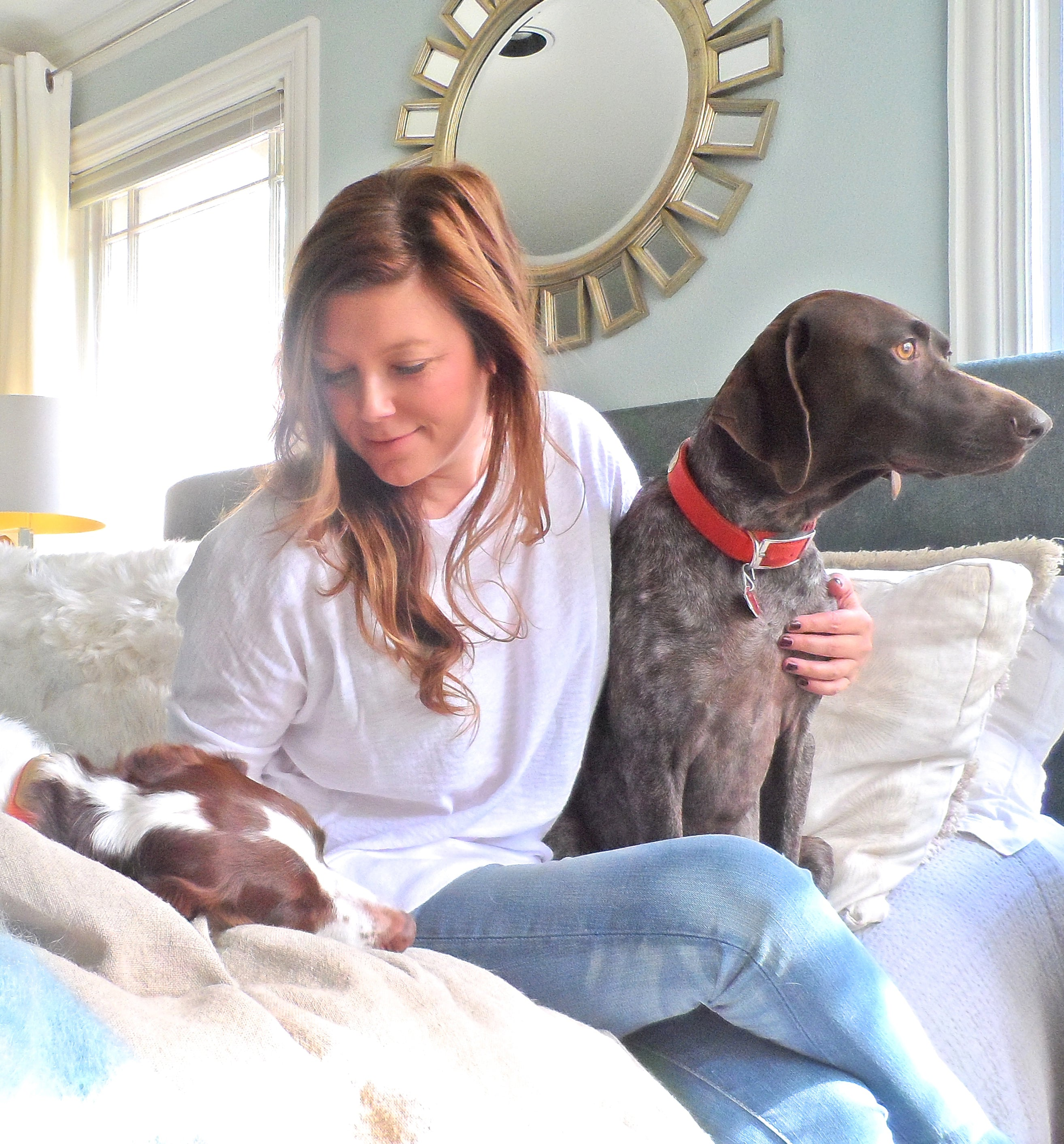 Abbe Fenimore of Studio Ten 25 relaxes at home with her dogs