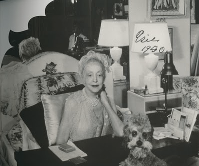 Elsie de Wolfe at her home in 1950 with her chintz husband pillow