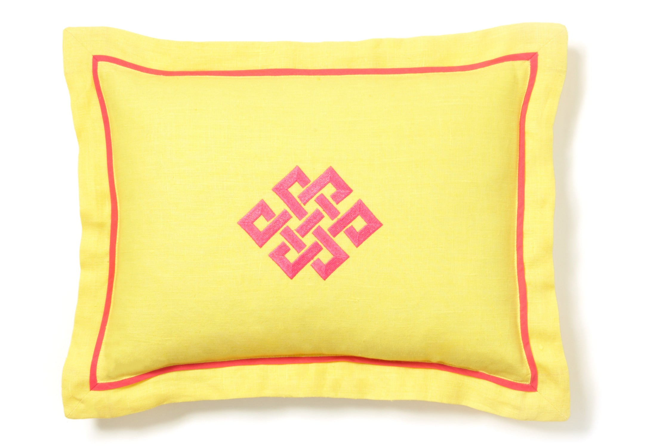 Yellow throw pillow with bright pink embroidery