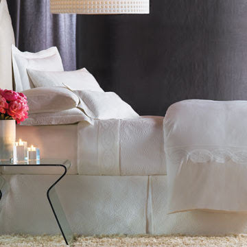 A romantically styled all white luxury bed