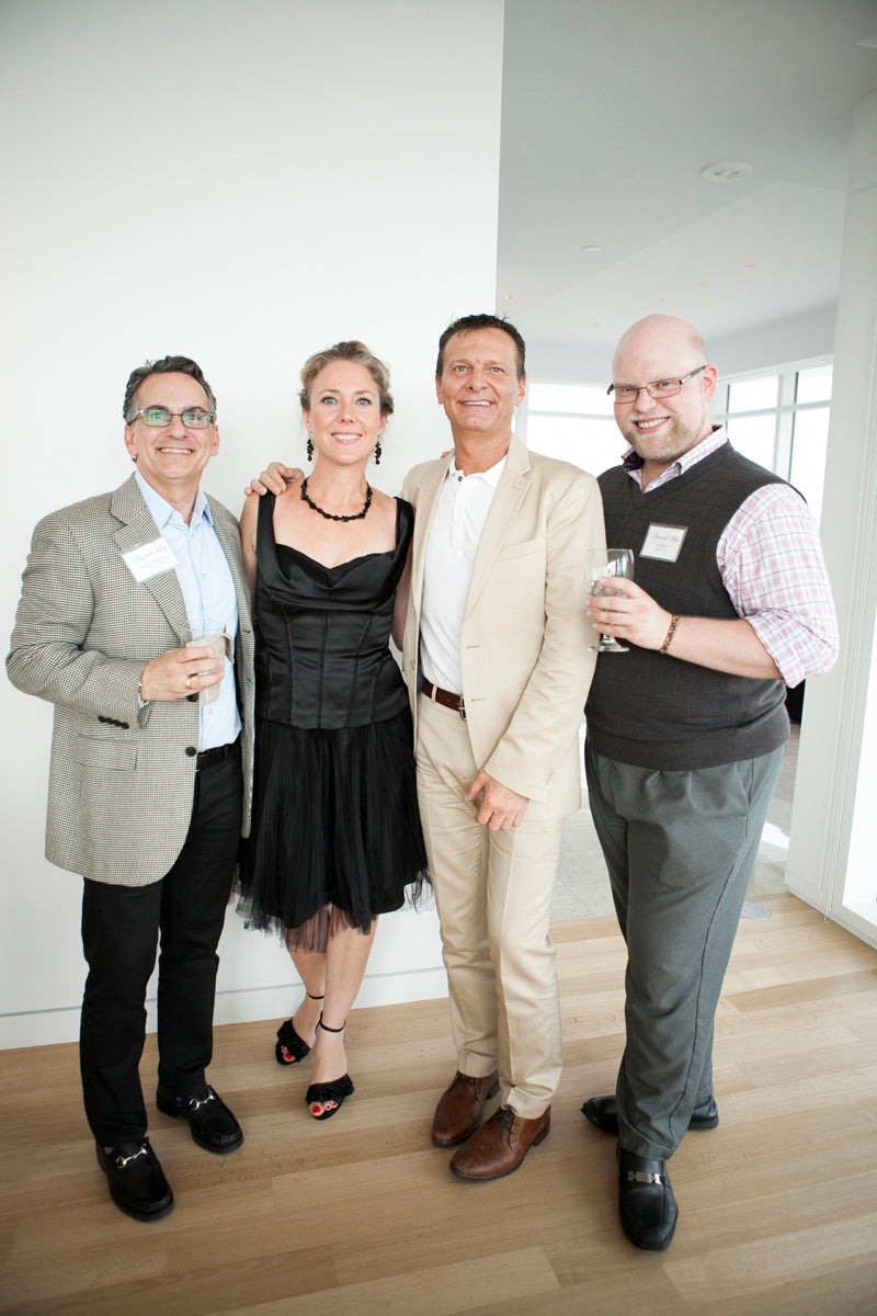 Four attendees pose at our Sales Meeting Cocktail Soiree