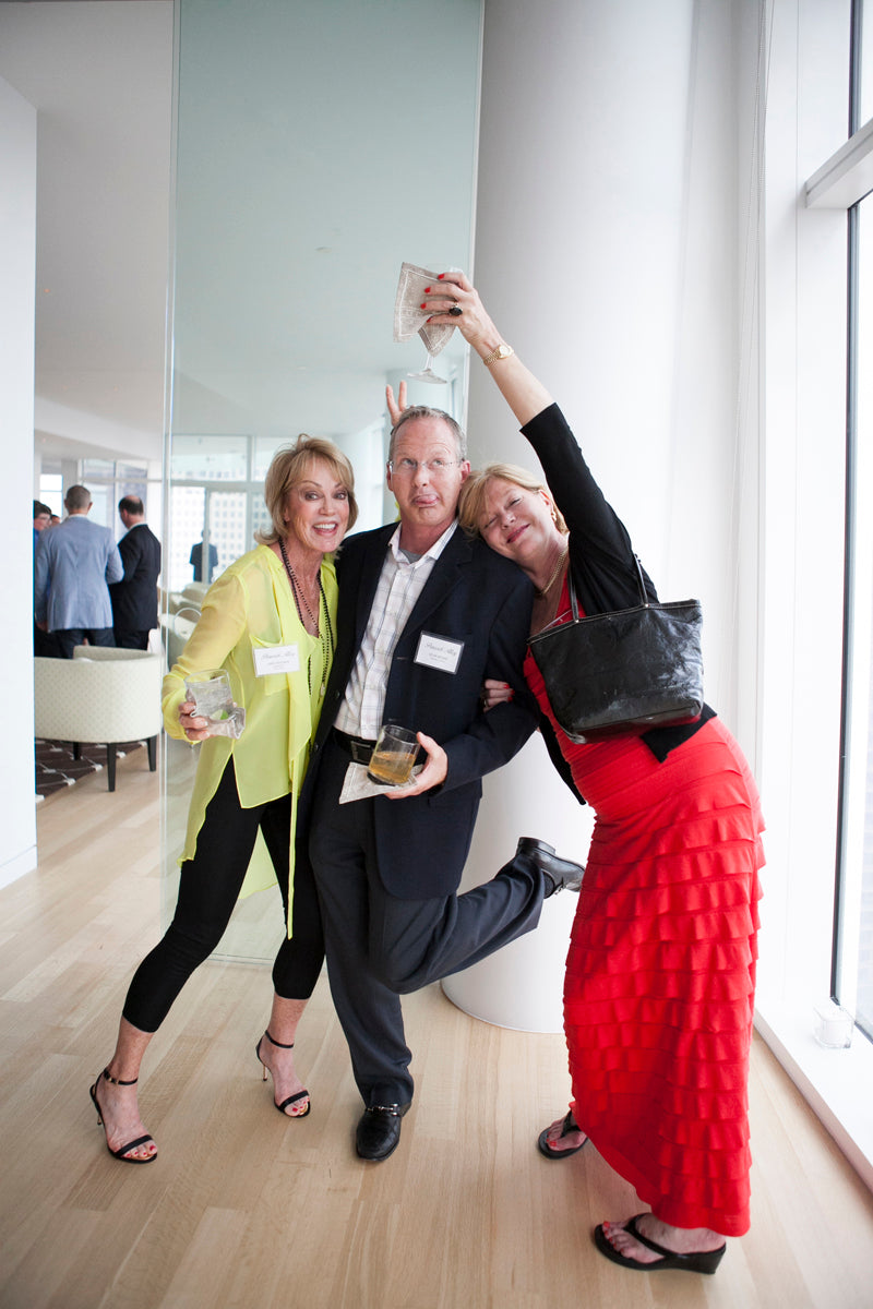 Three attendees strike a goofy pose at our Sales Meeting Cocktail Soiree