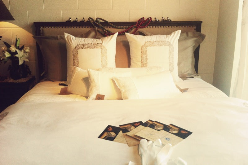 White luxury bedding accented with gold embroidery