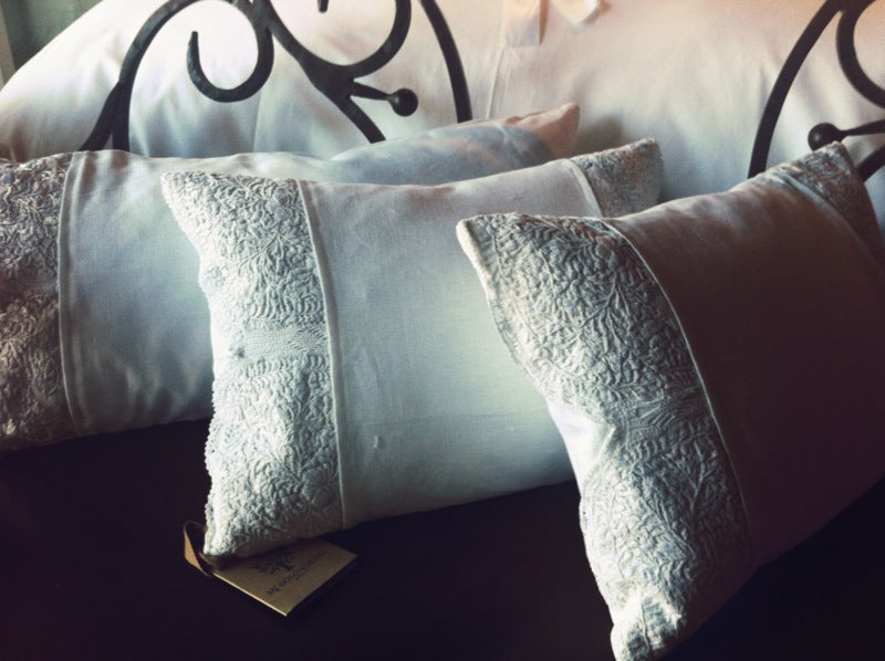 White pillows with Mexican lace detailing