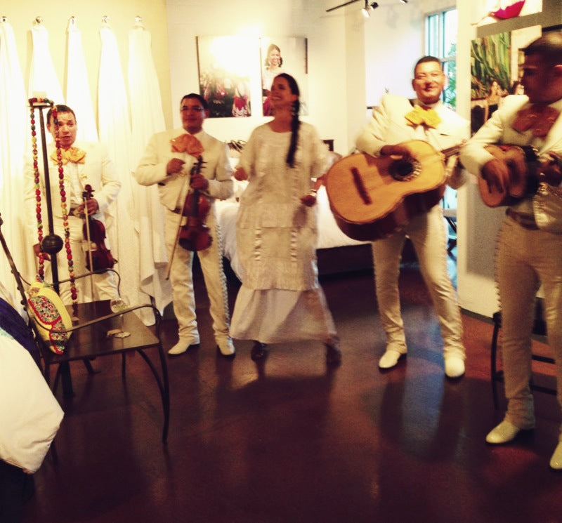 A live mariachi band entertains at a bedding and linens store