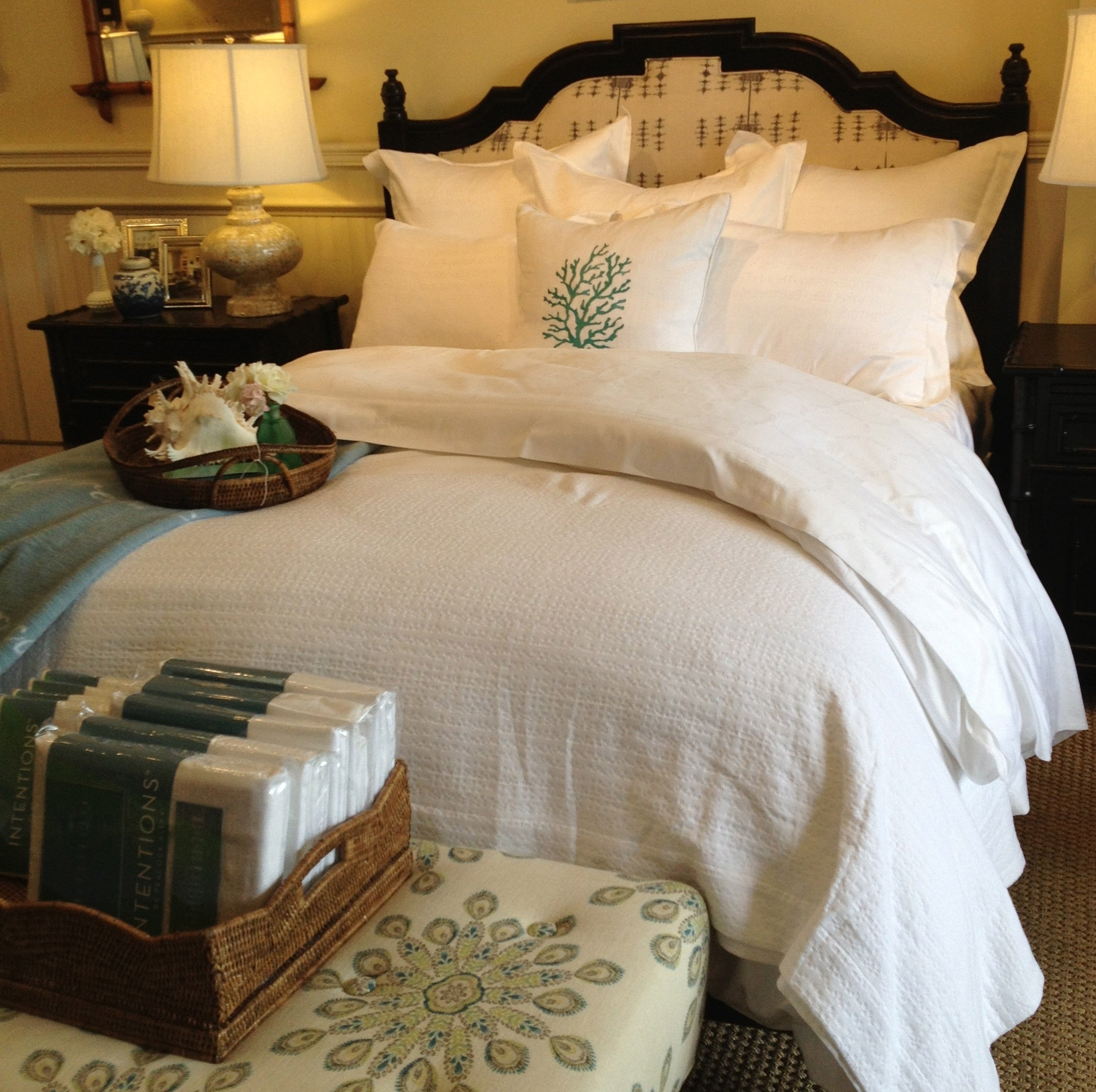 Classic bed styled primarily in white with green accents