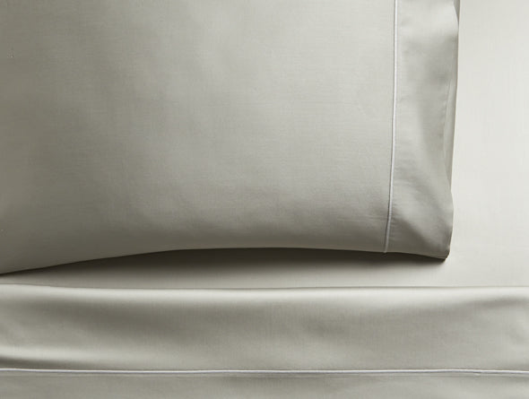 A closeup shot of fine sateen sheets and pillowcase