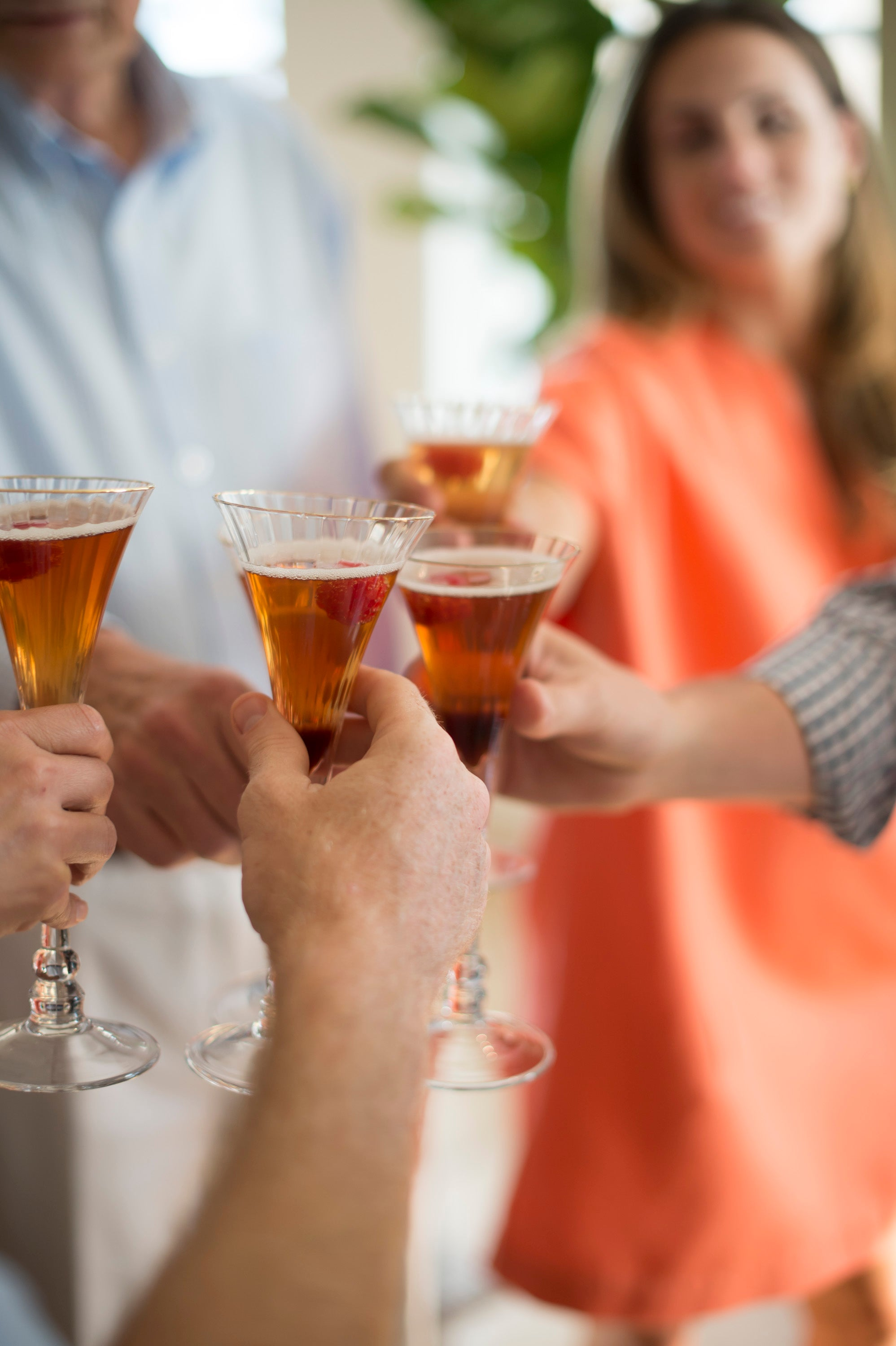 A group of people toasting