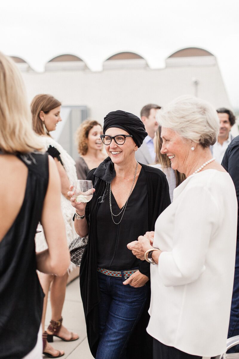 Mary Ella Gabler talks with guests at Peacock Alley's annual Sleep Under the Stars event