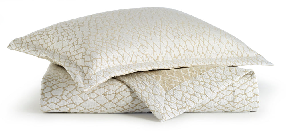 Matelassé coverlet and sham in linen and white with an exotic inspired pattern