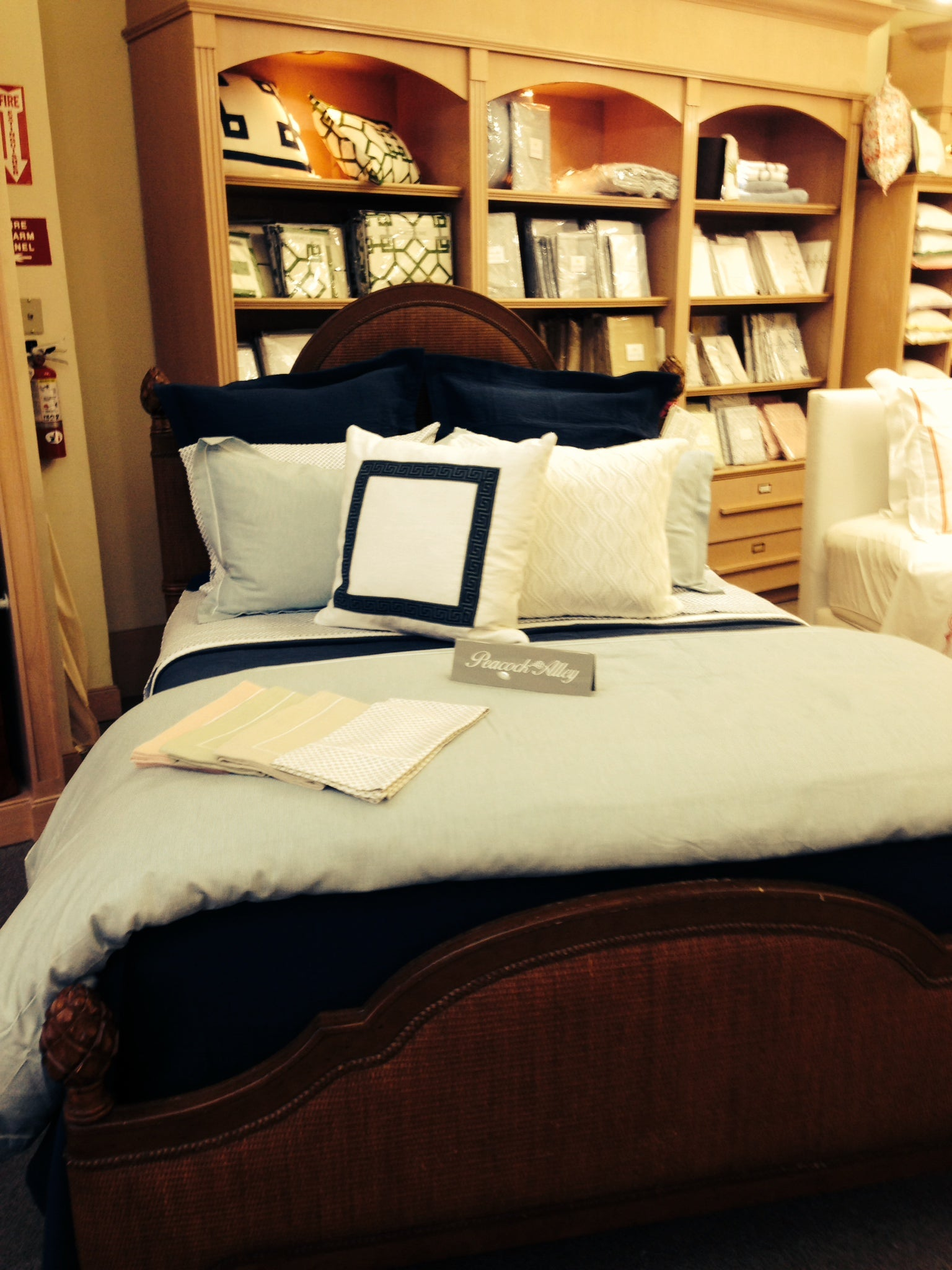 Store display bed dressed in Peacock Alley linens