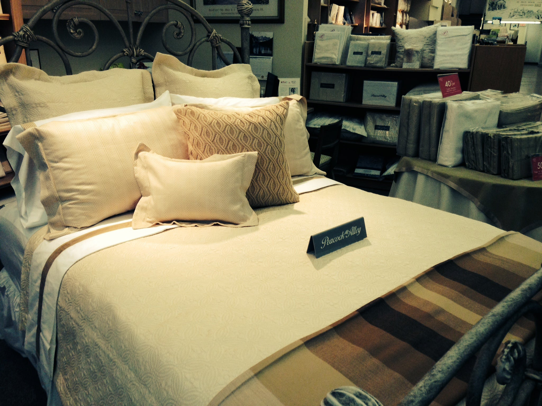 A store display bed in shades of gold and brown