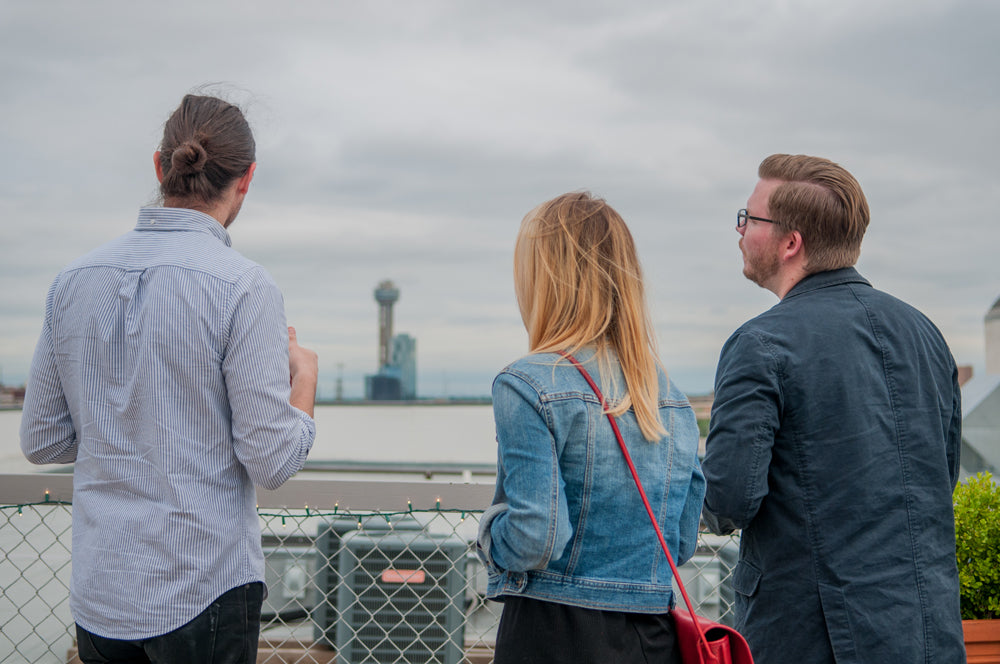 Guests look toward the Dallas skyline from the rooftop