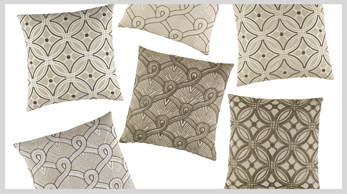 A collection of embroidered and beaded throw pillows in neutral tones
