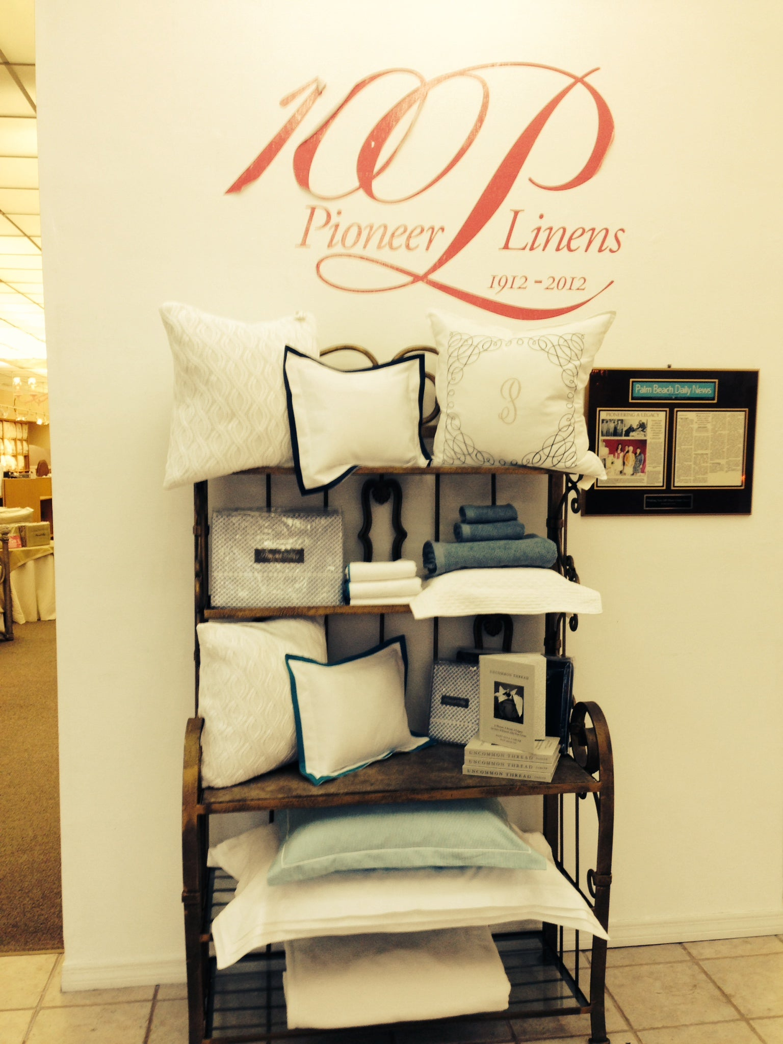 A display of pillows and other products sits at the entry way to Pioneer Linens