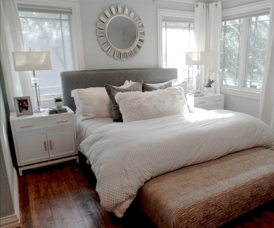 Bedroom in white and silver with wood accents