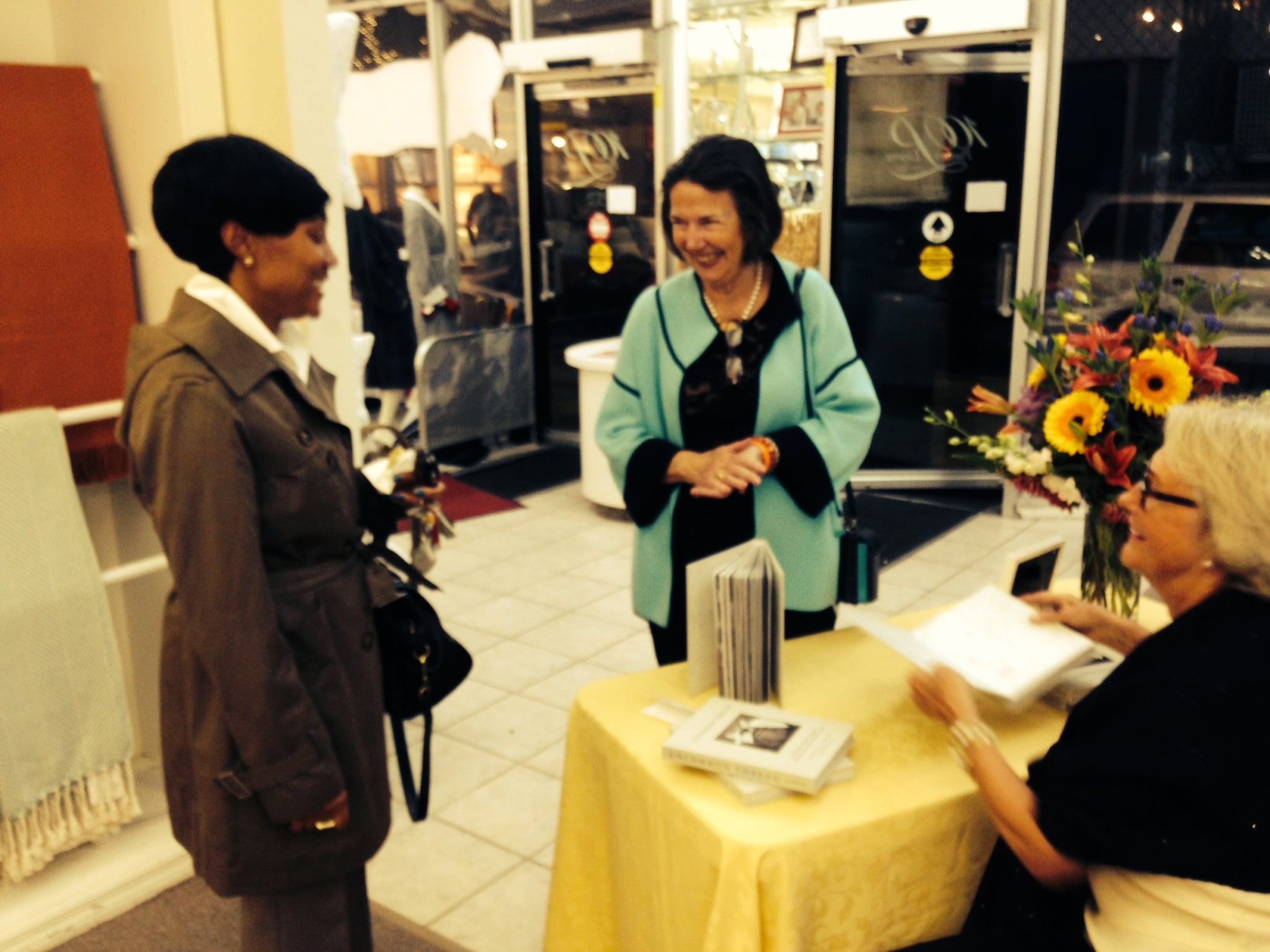 Mary Ella Gabler visiting with guests at a book signing for Uncommon Thread