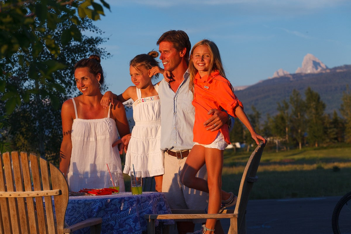 Josh Needleman and familybathed in the light of the setting sun in Idaho