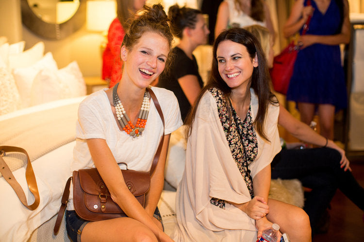 Meghan Graham and Bridget Hunt hang out at the Peacock Alley Design Studio during The Hundred Event Block Party