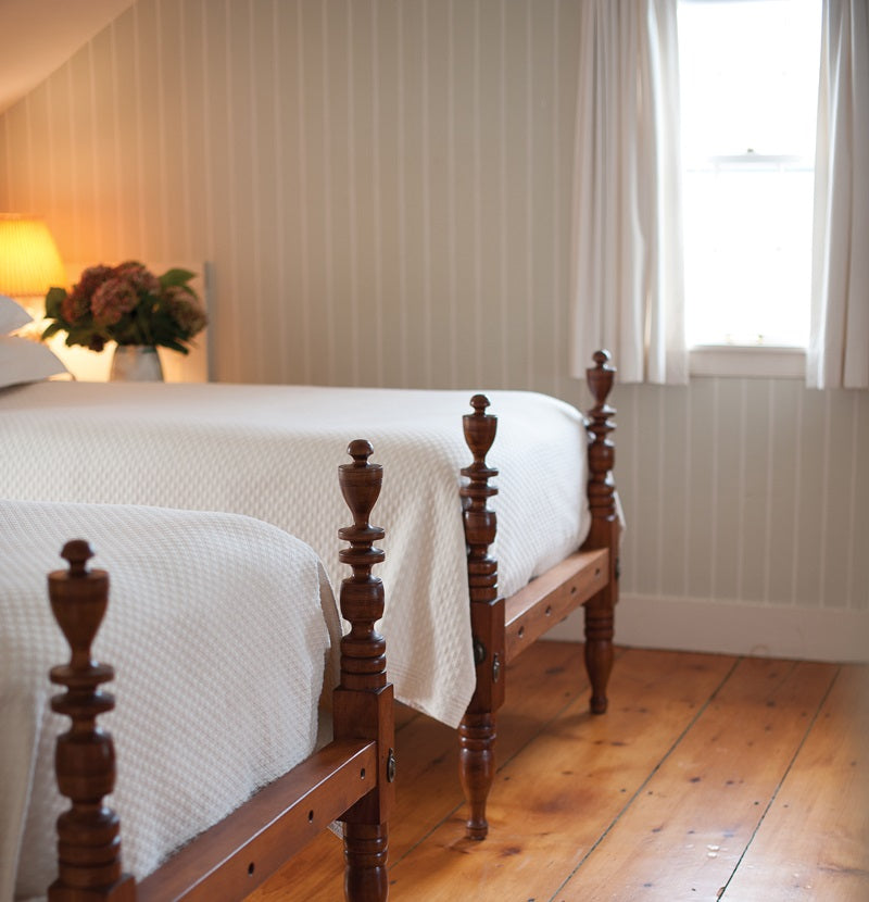 Two guest beds in classic white