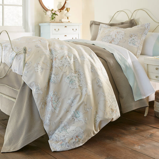 Floral printed duvet cover and shams on a bed