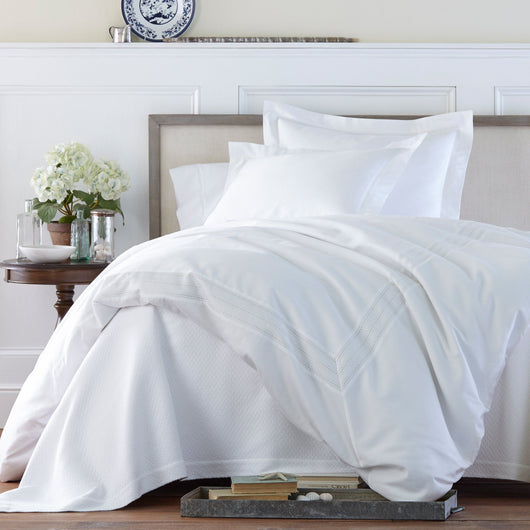 All white bed with white sateen duvet cover and white sateen shams