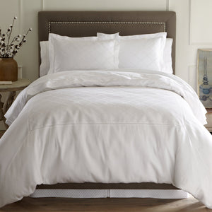 Lattice lace detail duvet cover and sham bed in white color