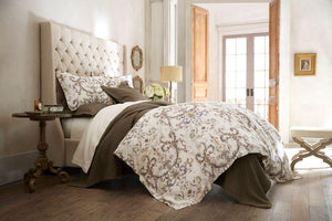 Light brown French medallion sateen duvet cover and sateen sham in a canopy bed