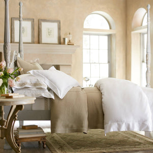 White sateen duvet cover draped over end of a bed