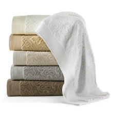 Load image into Gallery viewer, Stack of cotton bath towels with a classic damask pattern in white, linen, ivory, flint, and driftwood